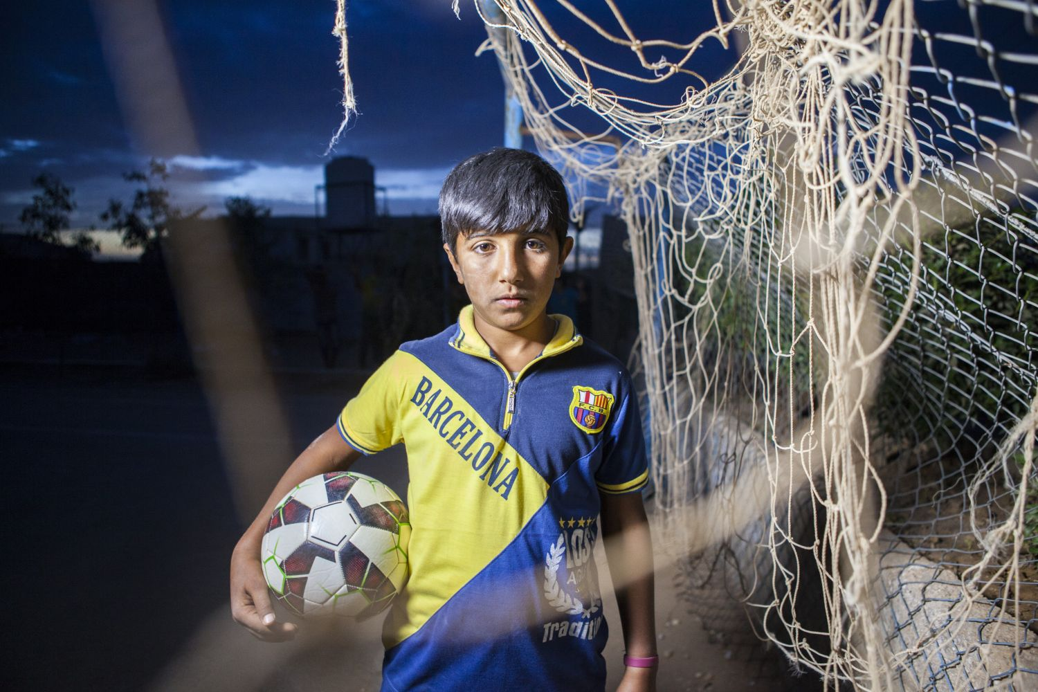 Ammar loves football. In Their Own Words, Film for UNICEF